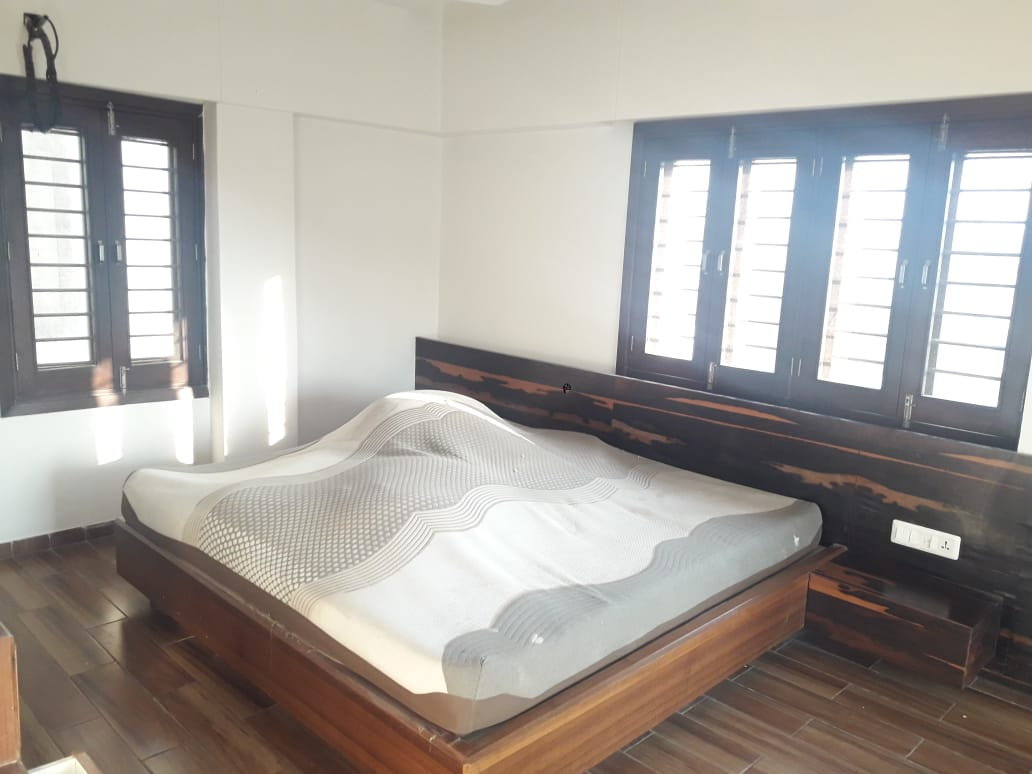 Akshat Flat Bedroom